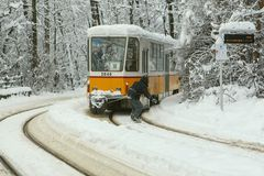 Extreme Snowboard ride behind a tram in Sofia Royalty Free Stock Photo