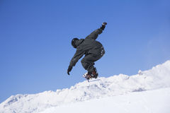 Extreme Snowboarder jumping Royalty Free Stock Image
