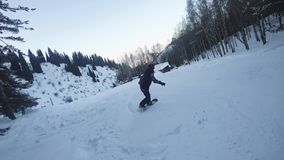Extreme snowboarder woman riding at mountain resort. Snowboarding stock video footage