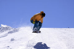Extreme snowboarding. Snowboarder jumping high on a snowboard at the ski resort Stock Image