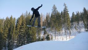 Extreme snowboarding and skiing stock video