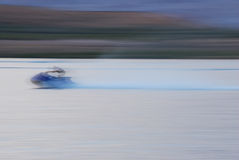 Extreme Speed. Extreme motion blur of high speed jet-skier Stock Photography