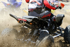 Extreme sport. A four wheel bike during action race Royalty Free Stock Photography
