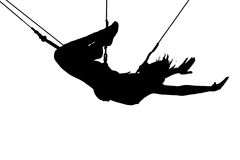 Extreme sport. Silhouette of young women on trapeze, white background Royalty Free Stock Images