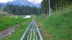 Extreme sport activity with bobsled in nature stock footage