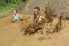 Extreme sport challenge jump in water. Sofia, Bulgaria - July 9, 2016: Participants are jumping into muddy water at the Legion Run extreme sport challenge near Stock Images