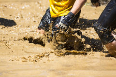 Extreme sport challenge muddy water Stock Images