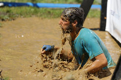 Extreme sport challenge muddy water Stock Photo