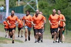 Extreme sport challenge running. Sofia, Bulgaria - July 9, 2016: Participants are running in a group at the Legion Run extreme sport challenge near Sofia. The Royalty Free Stock Image