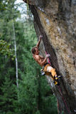 Extreme sport climbing. Rock climber struggle for success. Copy space. Royalty Free Stock Images