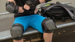 Extreme sport equipment wrist pad boy preparing stock video
