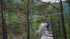 The guy on the bungee comes down over the river. Extreme sport. Extreme sport. The guy on the bungee comes down over the river stock video footage