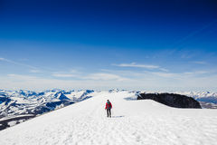 Extreme Sport. Lone hiker in winter mountains Stock Photos