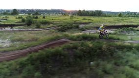 Extreme sport motocross racer driving fast terrain stock video footage