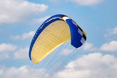 Extreme sport parachute in the sky Stock Images