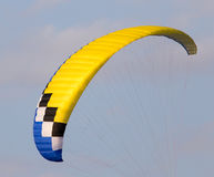 Extreme sport parachute in the sky. Extreme sport in the sky on a parachute royalty free stock images