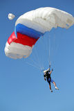 Extreme sport parachutist. On blue sky Stock Images
