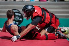 Extreme Sport: People Fighting Outdoors with Red Body Protective Gear.  Stock Photography
