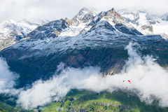 Extreme sport. This is a photo of paragliding fly over the cliff in Switzerland Stock Image