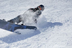 Extreme sport,snowboarder in action at the mountains Young man s Stock Images