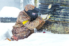 Extreme sport in winter in snowdrifts. Extreme sport paintball in winter in snowdrifts Royalty Free Stock Photography