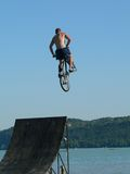 Extreme sports. Mountain bike water jump Royalty Free Stock Photo