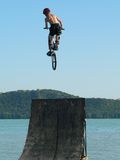 Extreme sports. Mountain bike water jump royalty free stock photos