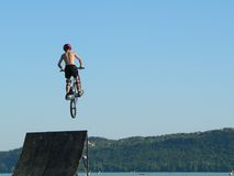 Extreme sports. Mountain bike water jump royalty free stock photo