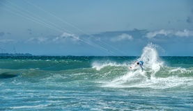 Extreme sports photography of athlete on kiteboard surfing. In tropical sea Royalty Free Stock Images