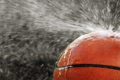 Extreme Spray Basketball. Water Splashing off a basketball royalty free stock image