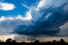 Extreme, stormy weather in germany. Clouds with blue sky in location by a extreme, stormy weather in germany Royalty Free Stock Image