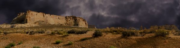 Glen Canyon Arizona Desert Dark Skies Weather. Extreme threatening clouds fill the Arizona sky over the harsh desert plains and plateaus of Glen Canyon stock photography