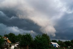 Extreme thunderstorm shelf cloud. Summer landscape of severe weather Stock Images