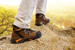 Extreme trekking boots on rocks. Royalty Free Stock Photos