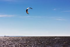 Kiteboarding at the gulf of finland. Extreme water sport - kiteboarding at the gulf of finland at summer sunny day Stock Images
