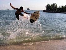 Extreme Wave skim boarding. An extreme form of surfing using a skim board that is more rounded than a normal surf board Stock Photos