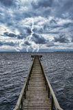Extreme Weather. Conditions from an approaching storm veiwed from a wooden pier on the coast Stock Image