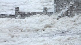 Extreme weather - wind and sea foam stock footage