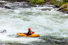 Extreme white water mountain canoeing Royalty Free Stock Photo