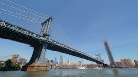 Extreme Wide Angle Establishing Shot of Manhattan Bridge and Skyline. An extreme wide angle establishing shot of the Manhattan Bridge with the New York City stock video footage