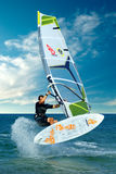 Extreme windsurfing trick stock photography