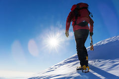 Extreme winter sports: climber at the top of a snowy peak in the Stock Photography