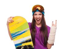 Extreme woman with broken arm and snowboard Stock Images