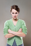 Extremely aggressive looking young woman. Half length portrait of an extremely aggressive looking young woman royalty free stock photo
