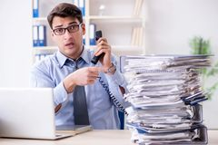 The extremely busy businessman working in office. Extremely busy businessman working in office Stock Photography
