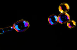Extremely colored soap-bubbles Stock Photos