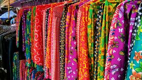 Colorful clothes on a market in north Vietnam royalty free stock image