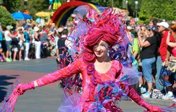 An extremely colorful Disney character performs in a Magic Kingdom parade Royalty Free Stock Image
