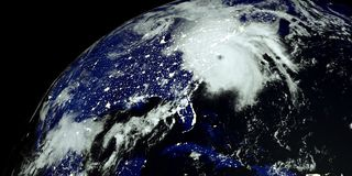 Extremely detailed and realistic high resolution 3D illustration of a Hurricane at Night hitting the US East Coast. Shot from Spac Royalty Free Illustration
