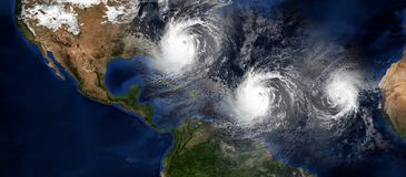 Extremely detailed and realistic high resolution 3d illustration. Of 3 hurricanes approaching Northeastern USA. Shot from Space royalty free illustration